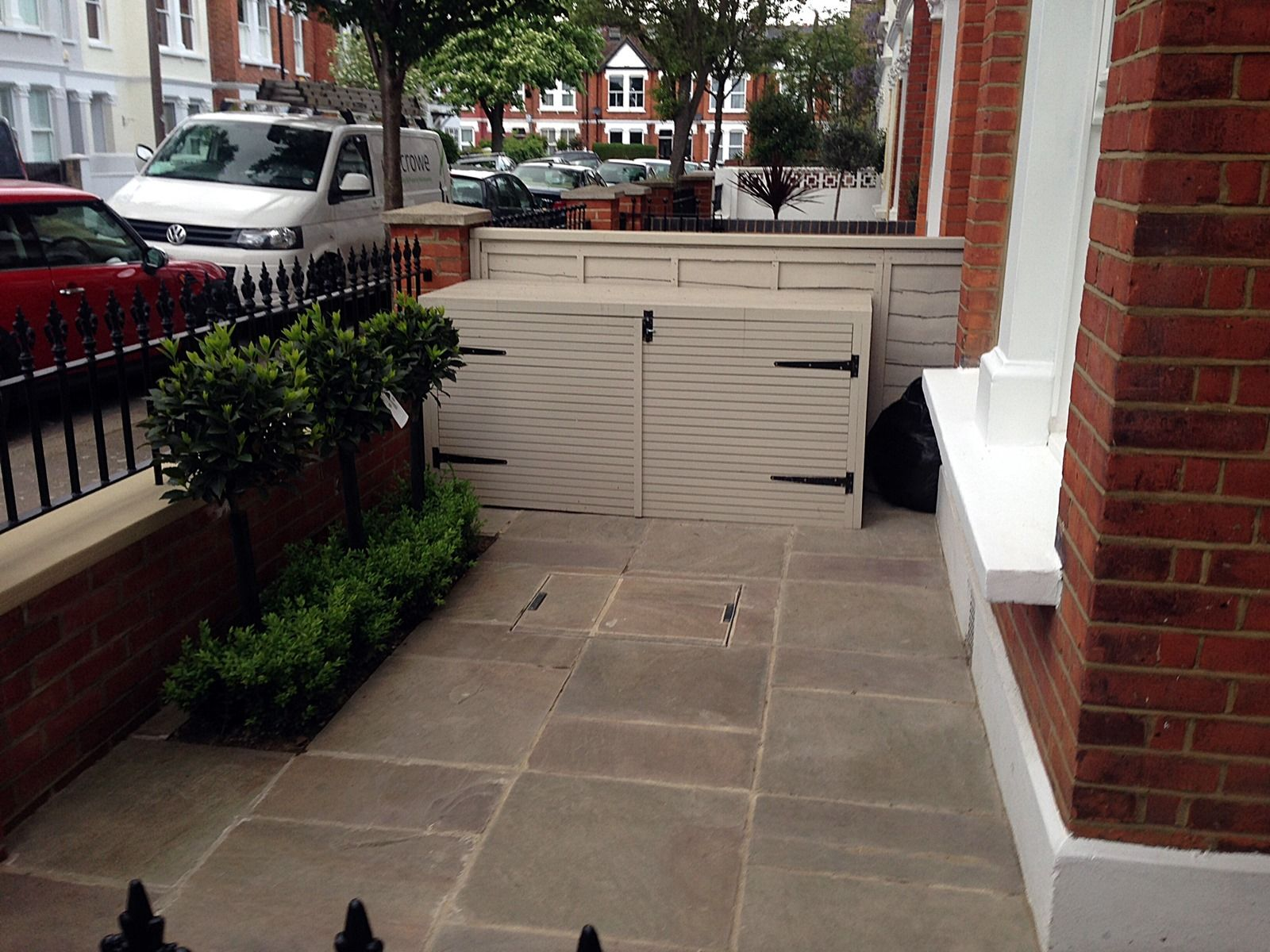 red-brick-front-garden-wall-yellow-stone-caps-sandstone-paving