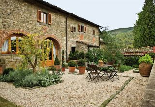 Love the colors. Rustic Outdoor Space by Spectrum Interior Design and Marco Vidotto in La Convertoie, Italy