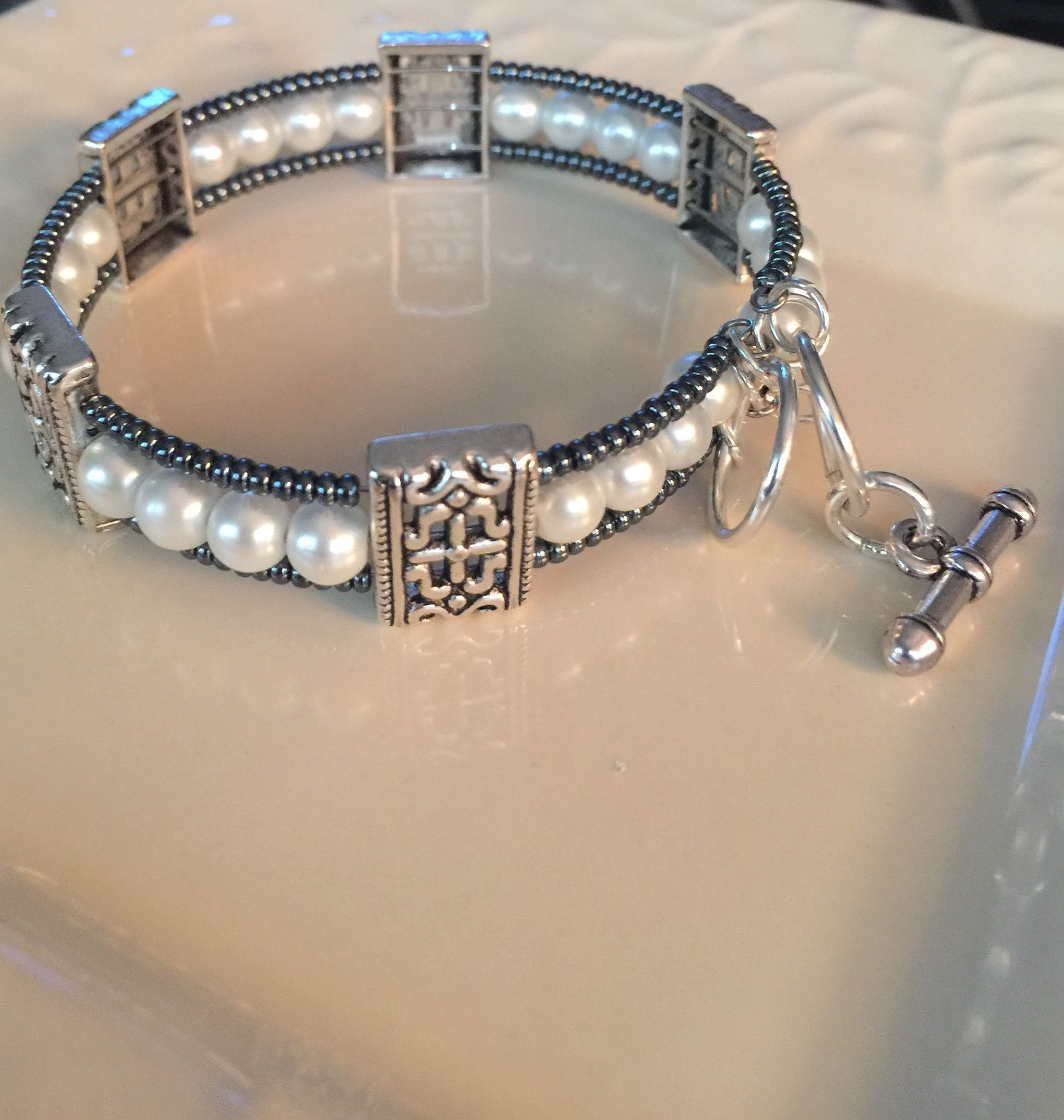All jewelry is handcrafted with glass beads and silver plated accents. - Bracelets are made with a memory wire material and easy clasp closure, so it will fit all wrist sizes comfortably.                                                                                                                                                     More