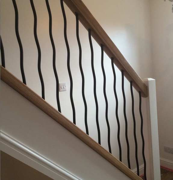 Using Our Wavy Wrought Iron Spindles And Oak Handrail We Updated This  Staircase And It Looks