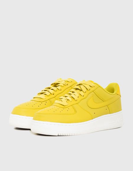 a62d83ef4a The NikeLab Air Force 1 Low Men's Shoe fully dressed in bright citron.  Finishing details include graphic insoles, a semi-translucent outsole,  white midsole ...