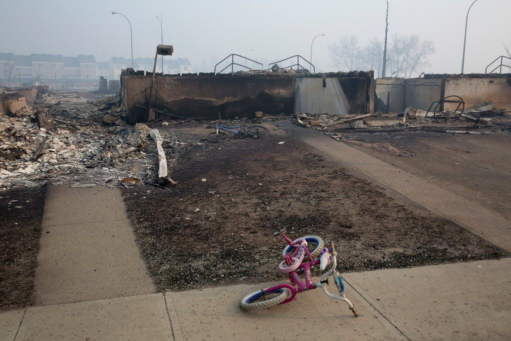 The entire population of Fort McMurray, the main center for Canada's oil sands region, was ordered to evacuate on Tuesday evening once the fire, which began in woodlands outside the city, had overwhelmed firefighters' efforts to hold it at bay.