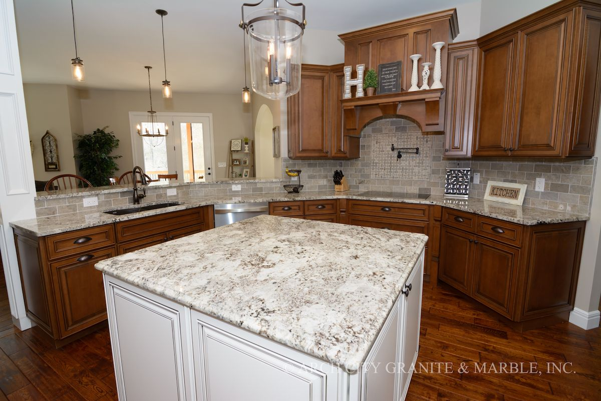 Alaska White Granite Kitchen Island With White Cabinets In A Wentzville, MO  Home