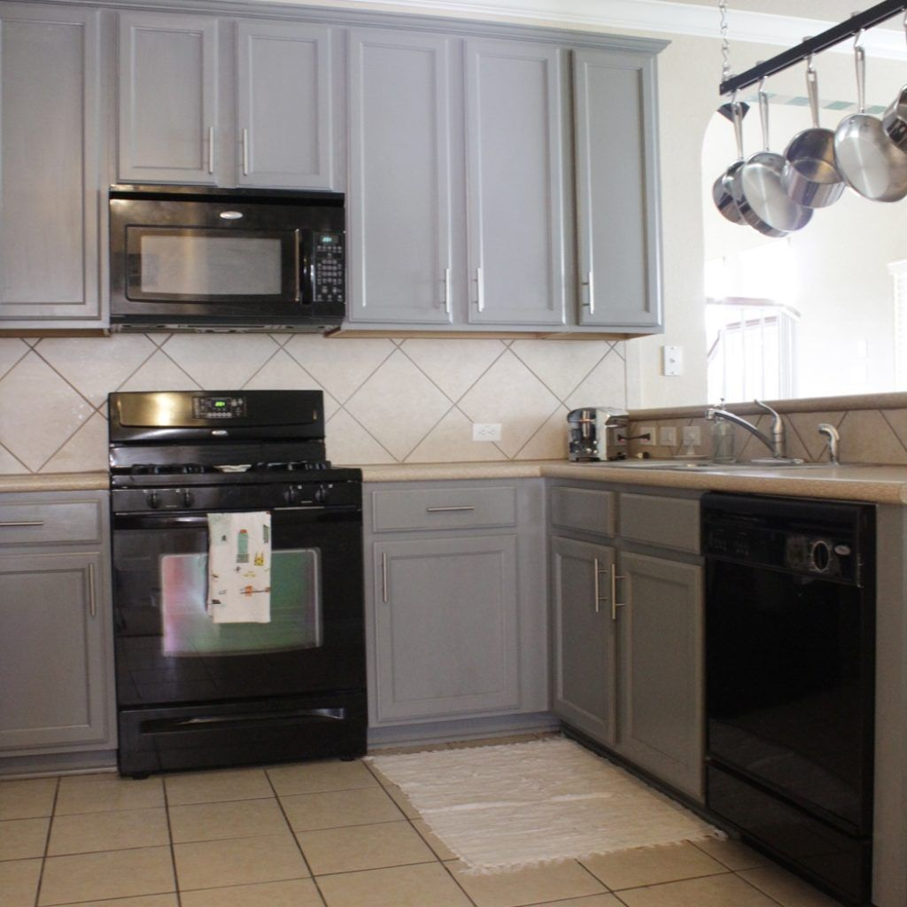 gray kitchen cabinets with black appliances