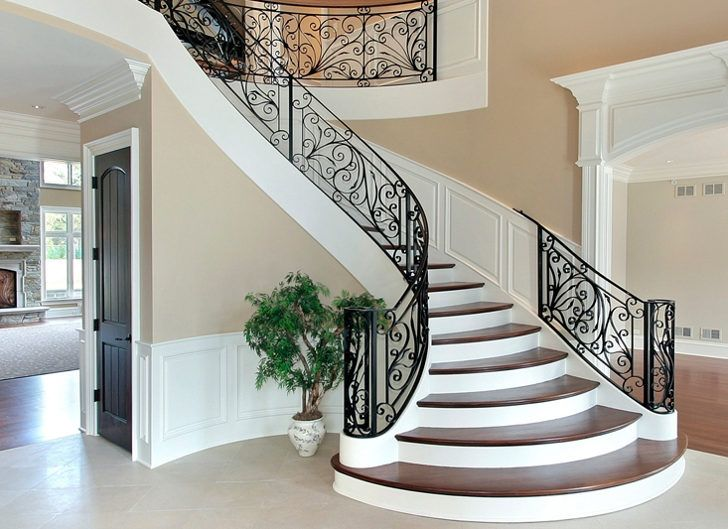 staircase designs for homes. I love the wainscoting but really like swirl at bottom  with bigger stairs