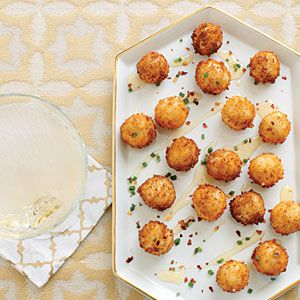 Our Best Party Appetizers | Goat Cheese Poppers with Honey | CoastalLiving.com. http://www.coastalliving.com/food/our-ten-best-party-appetizers-00400000060747/page31.html