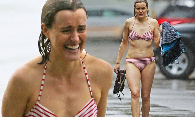Taylor Schilling keeps smiling as she braves downpour in Hawaii