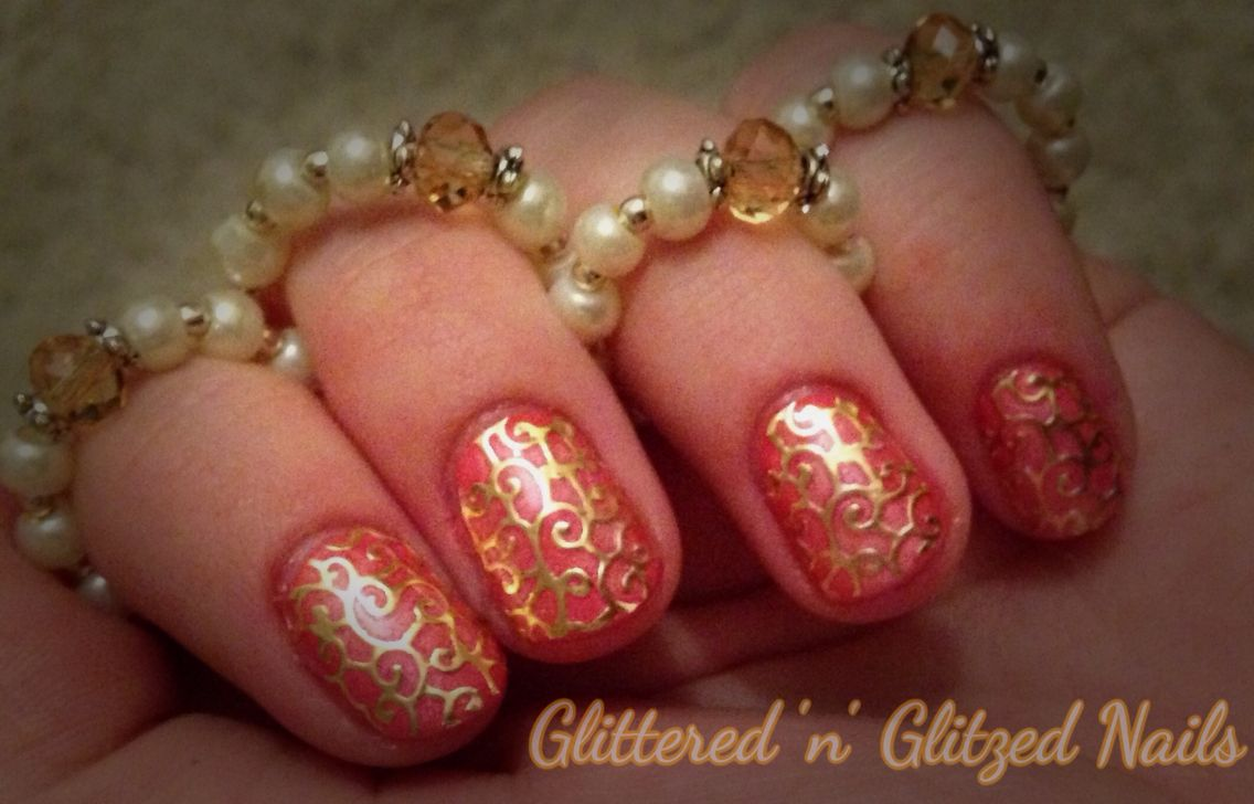 A coral gelish gel polish with a bit of pigment powders and filigree nail art x
