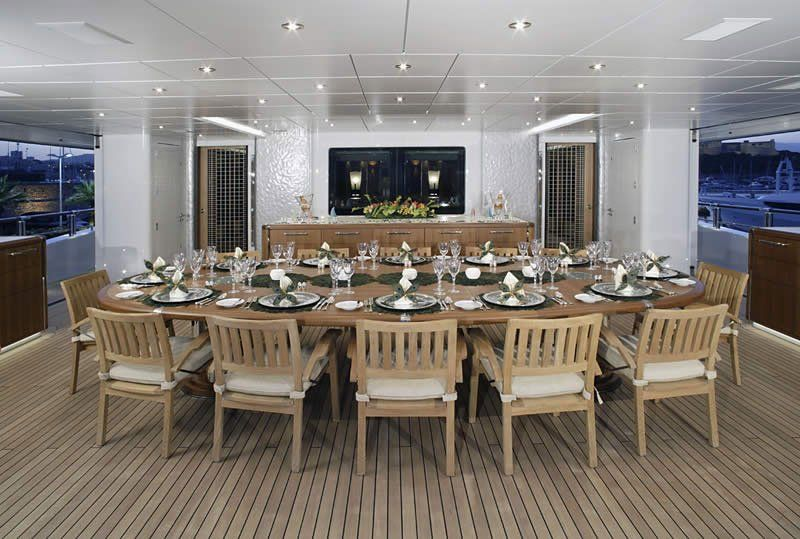 Yacht of the week this sick megayacht has a disco club for 12 person outdoor dining table