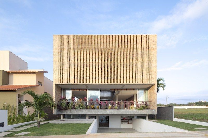 A Residence With A Perforated Brick Facade And A Dual Nature ...