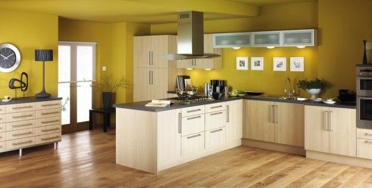 Naturally kitchen design combination with yellow wall color | Home ...