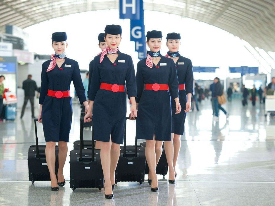 The Most Stylish Flight Attendant Uniforms in the Sky Navy shirt - air jamaica flight attendant sample resume