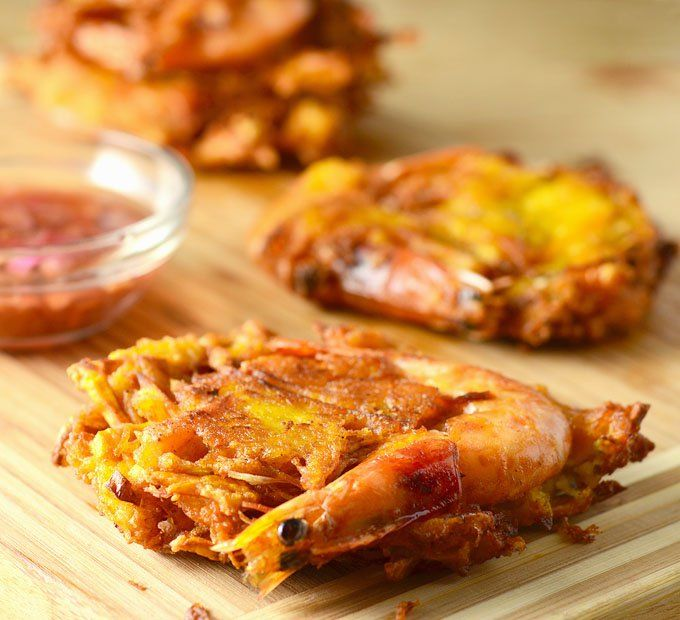 Ukoy are Filipino fritters made with shredded green papaya, Kalabasa squash and shrimp