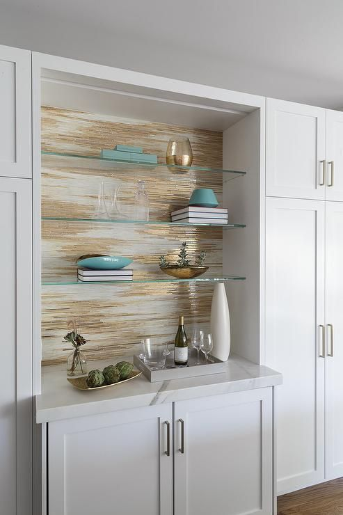 Gray And Gold Metallic Wallpaper Is Fixed Behind Stacked Glass Front Shelves Mounted Above White Sh Glass Shelves Gold Metallic Wallpaper Glass Shelves Kitchen