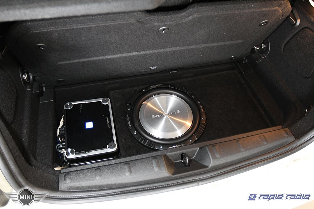 Custom Installed Stealth Subwoofer And Low Profile Amplifier Into
