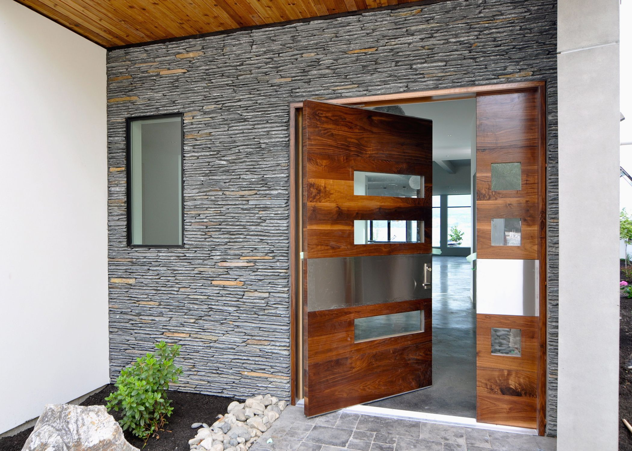 Panagea Natural Stone Microledge West Coast This Modern Entry Way Sure Makes For A One Of A Kind R Wide Front Doors Modern Entry Door Door Design Modern