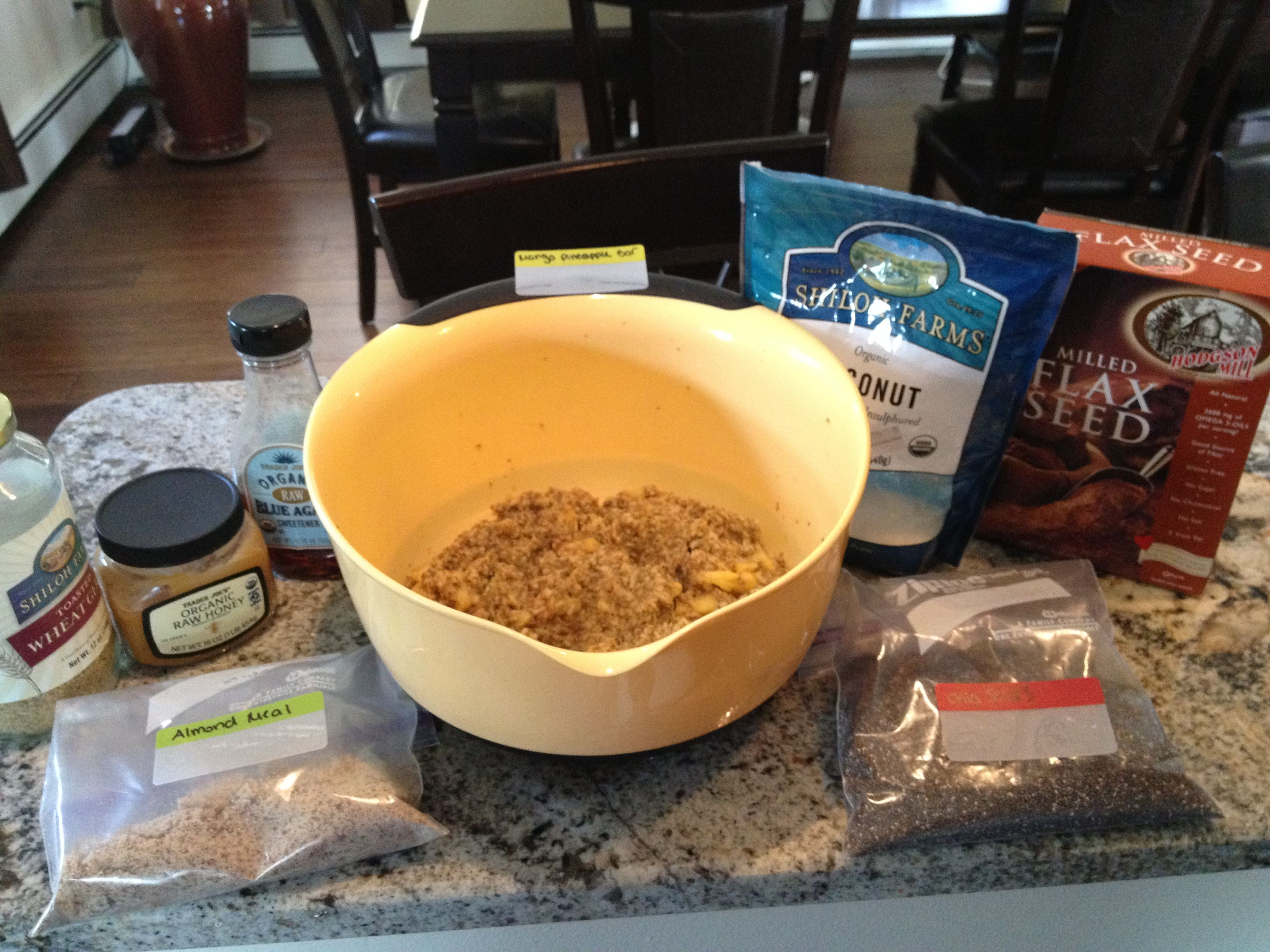 Ingredients in the mango pineapple batter: raw almond meal (works as flour substitute), flax meal (works as egg substitute), unsweetened coconut, raw agave and raw honey (sugar substitute), wheat germ, chia seeds (creates a gelatinous texture when added to liquid and helps bind the ingredients), and fresh pureed mango and pineapple