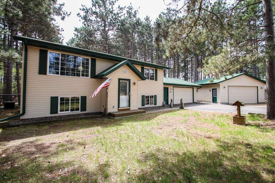 Own your own little bit of country in town. This 4 BR 2 BA home sits on 1.39 wooded acres. Oversized 2 car attached garage. 26x24 detached garage with cement flr & electricity. 12x8 Shed. Dog kennel, heated dog house & partially fenced bkyd.