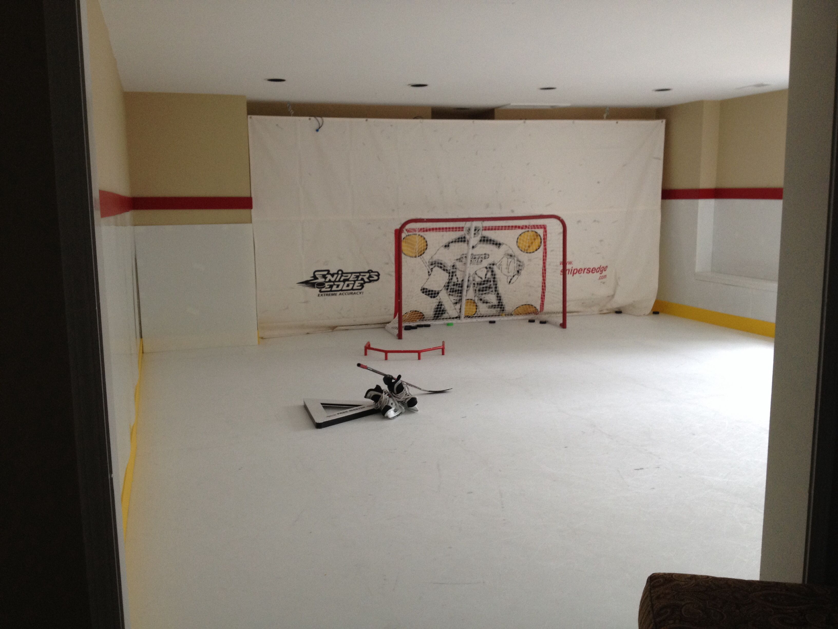 synthetic ice rink in our basement for the boys u003d fun look
