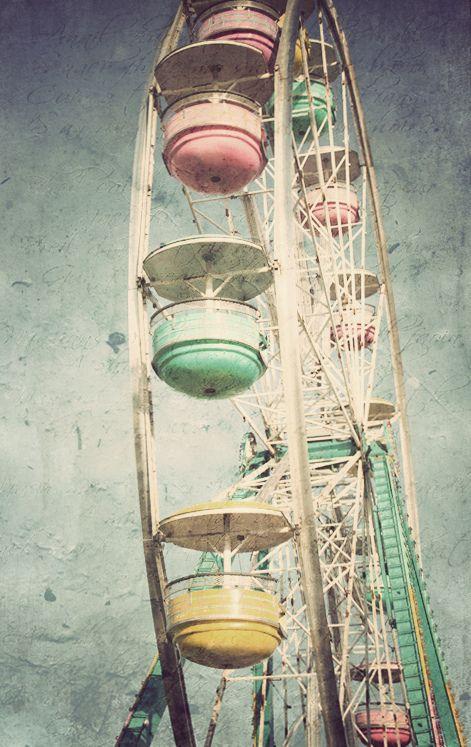 We're imagining swinging around this vintage pastel merry go round.