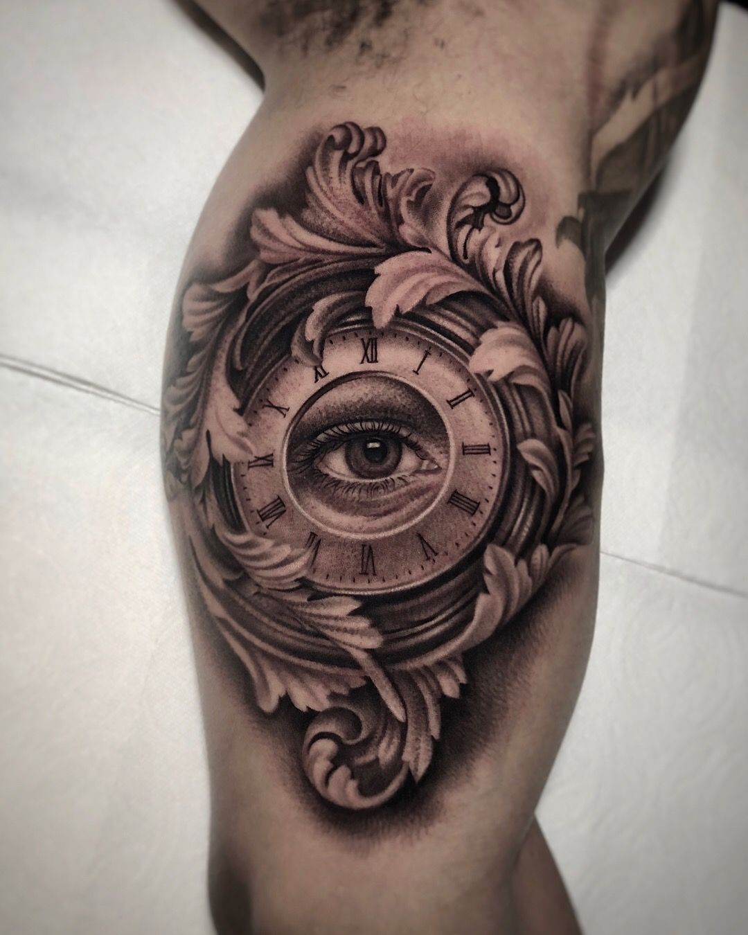 Black and grey eye clock tattoo by artist Kiljun. 시계 문신