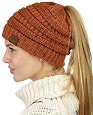 Make this crochet Katniss messy bun hat in just a couple of hours. The  pattern is inspired by the main character Katniss of the Hunger Games. e57e37a4c33