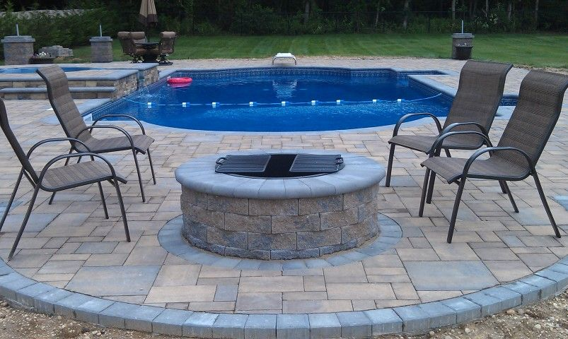 This Fire Pit Is Cambridge Pavers Wood Burning Round Fire Pit Kit It S Perfect For Any Backyard Pool Patio Fire Pit Near Pool Paver Fire Pit Fire Pit Kit