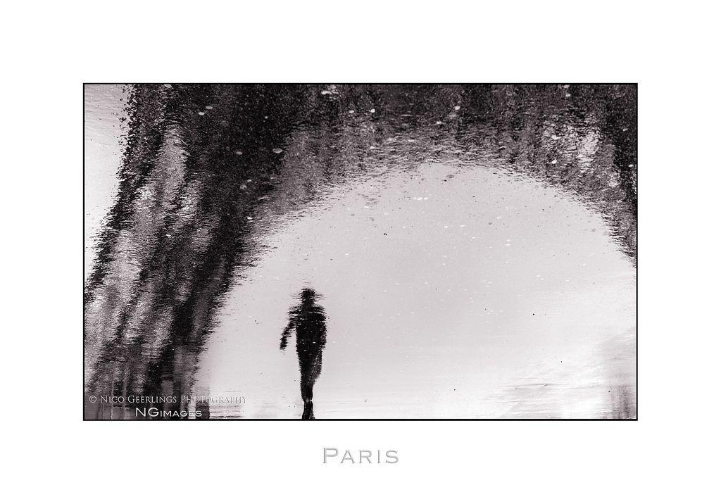 Paris n49 Man Under The Tower by Nico Geerlings
