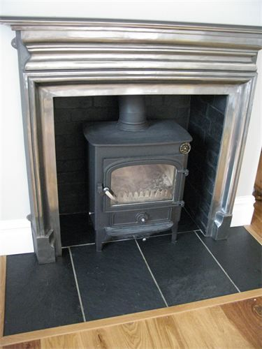 Clearview vision 500 wood stove installation : On black slate hearth and blacked out inglenook with metal surround