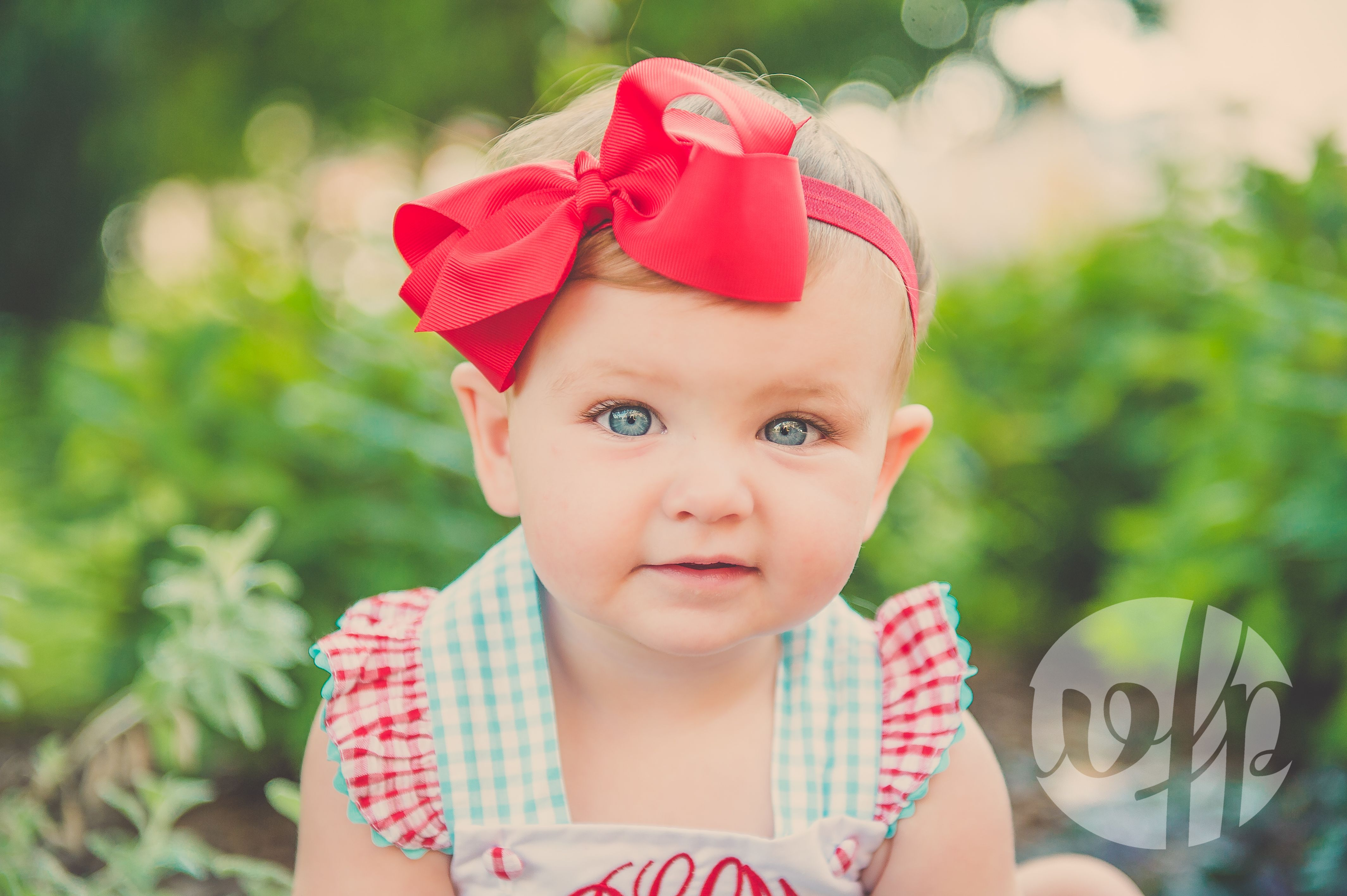 Pink and gingham to celebrate this sweet little girl. Taken downtown Fayetteville, Arkansas. Children and family photographs by Whitney Flora Photography.