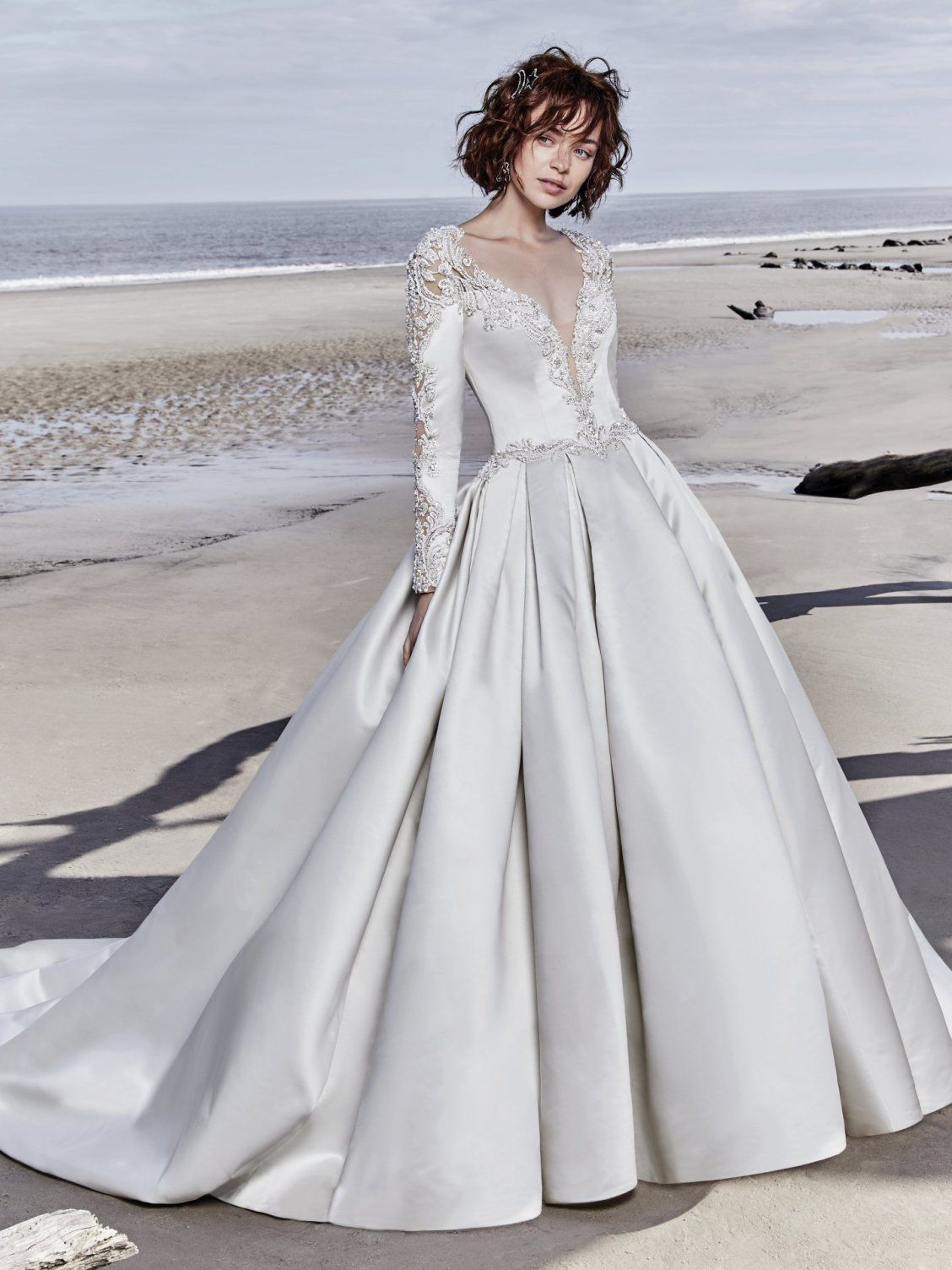 970af0c927 ... This breathtaking Carlo Satin wedding dress features long sleeves  accented in exquisite illusion lace details and beading. Swarovski crystals  adorn the ...