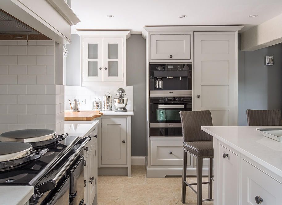 Modern Miele appliances sit across from a traditional AGA in this ...