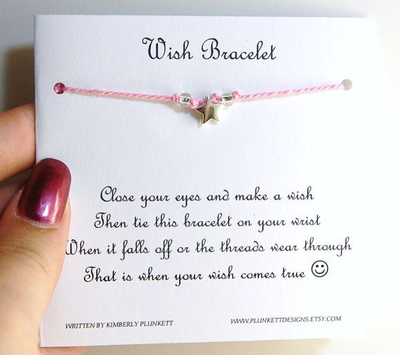 Wish bracelet poem. Just a record card with the poem written on and 2  notches for the bracelet to hug.