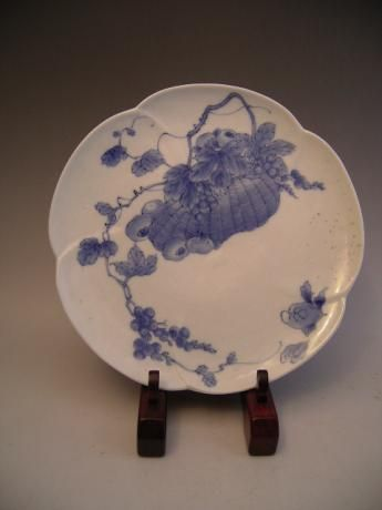 Japanese 19th Century Hirado Ware Plate with basket filled with grapes and persimmons.