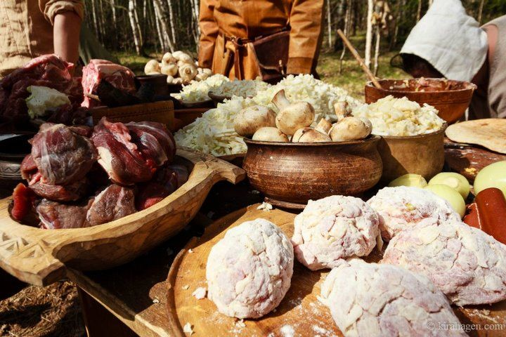 Viking Rus food being prepared. The meat patties in front are ...