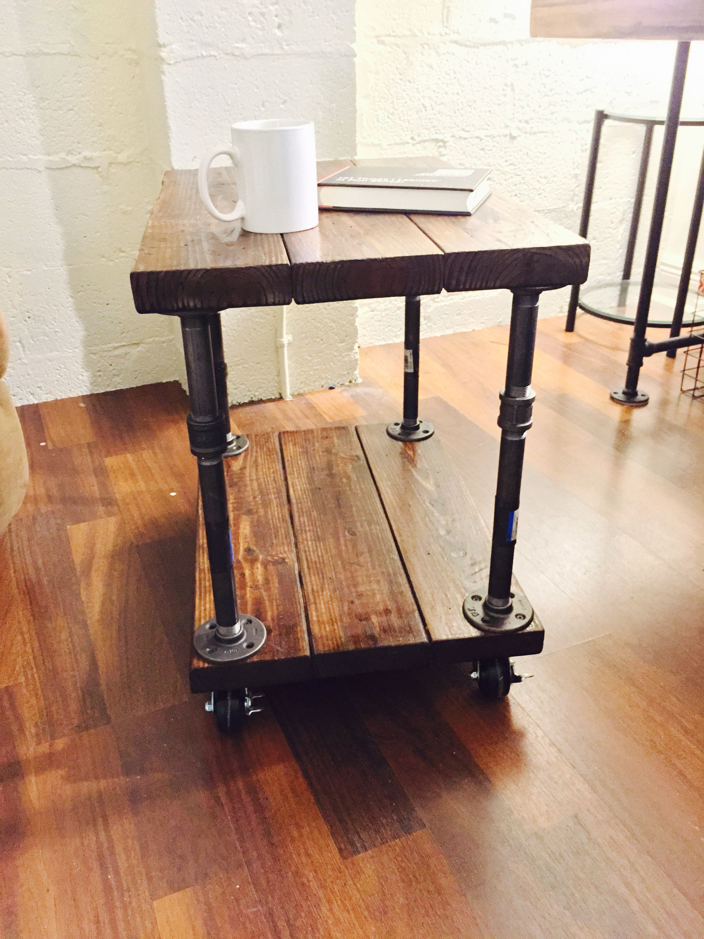 Beautiful industrial style coffee or end table made from reclaimed reclaimed industrial style side or coffee table with pipe base and full swivel casters made custom to your order geotapseo Image collections