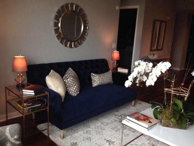 Navy Blue Velvet Sofa Starburst Mirror And Large White Cocktail Table Rooms Home Decor Glam Living Room Apartment Living Room