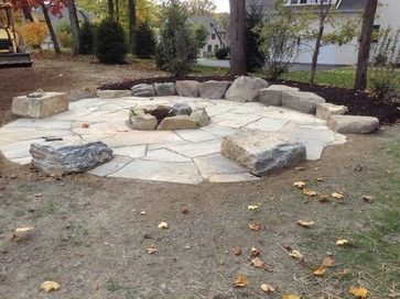 Large Fire Pit Area With Boulder Tables And Rock Wall Seating Custom Fire Pit Landscaping Fire Pit Patio Fire Pit Area