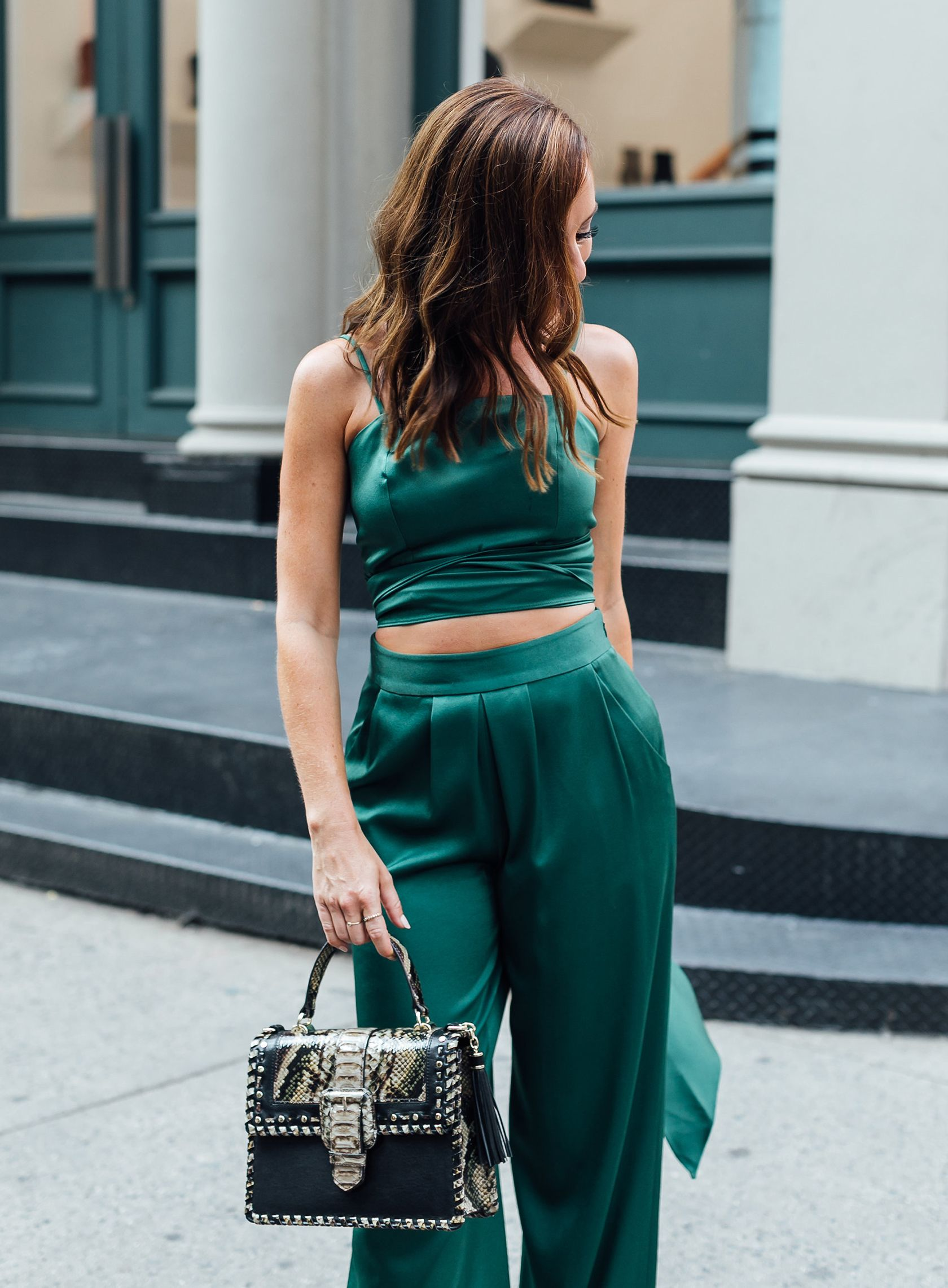 aab0a84e63f5 Sydne Style shows fall outfit ideas in emerald green pants  green  emerald   croptop  jeweltones  sydnesummer