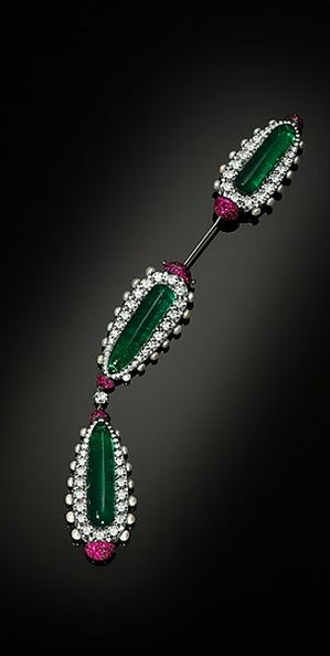 Jabot or Cliquet Brooch by JAR, 2013. Silver and gold, set with emeralds, diamonds, pearls and rubies