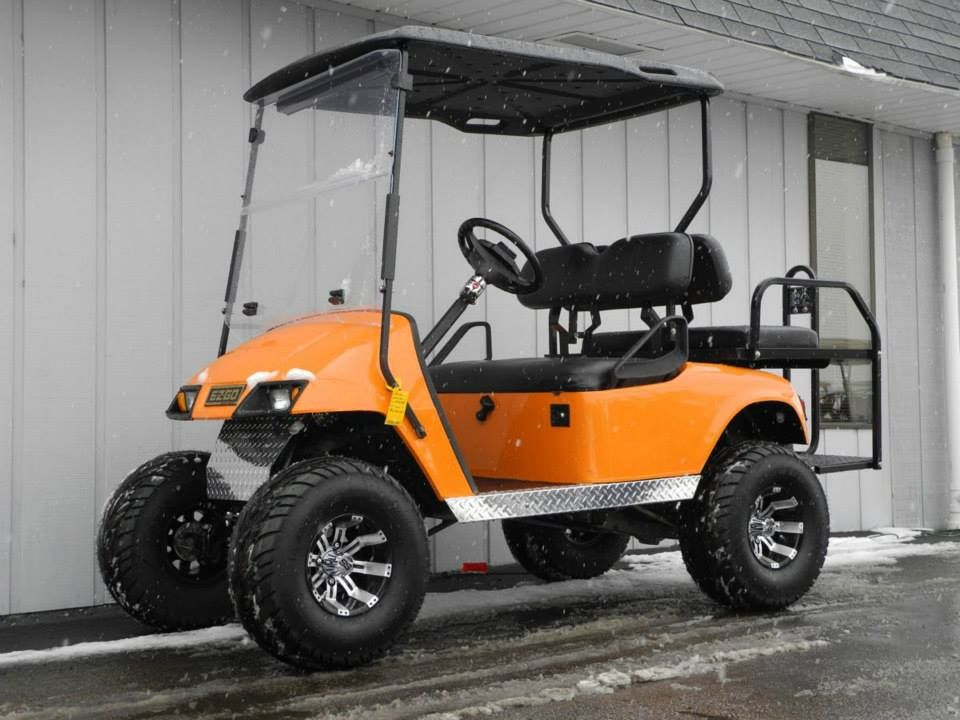 This Very Cool 2000 E Z Go Street Ready Gas Golf Car Features A Custom Orange Paint Job And Is Decked Out With Upgrades Custom Golf Carts Golf Car Golf Carts