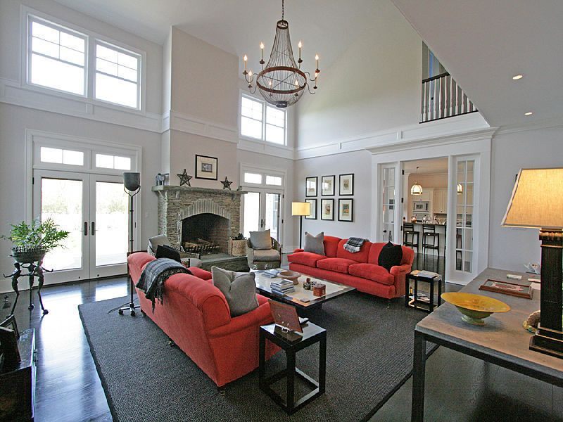 The Super High Ceiling And Chandelier Make This Living Room Seem Even More Grand