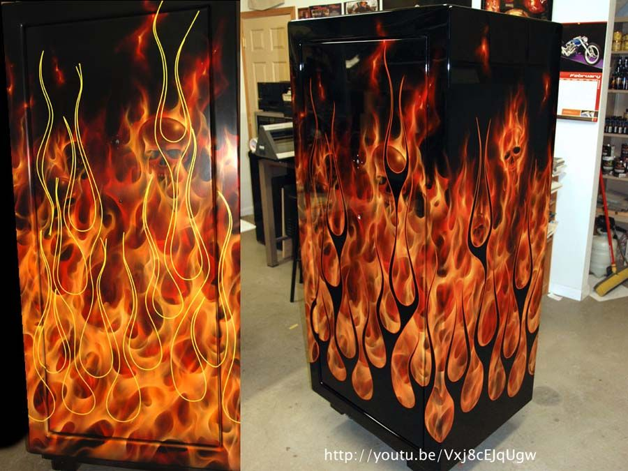 Orange True Fire gun safe with skulls and added black, striped hot rod flames. www.madshadowcustompaint.com