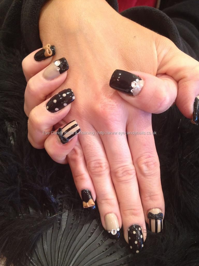 Nude and black freehand nail art with Swarovski crystals and 3D bows ...