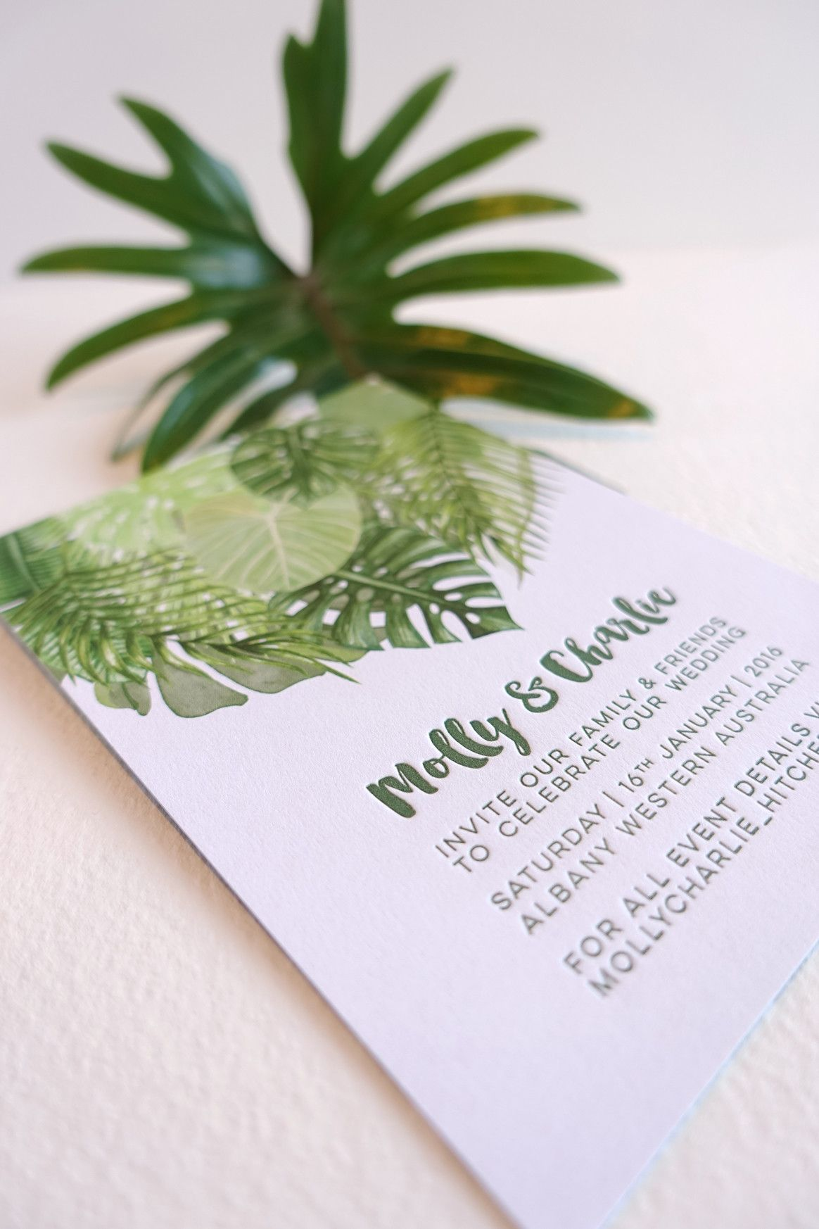 Tropical palm leaves invitation with letterpress text. Printed in ...