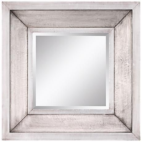 A decorative wall mirror in a lustrous silver finish frame.