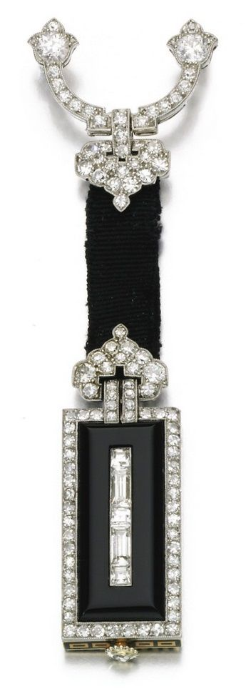 An Art Deco lapel watch, Cartier, circa 1925. The oblong polished onyx case accented with single-cut, baguette and rose diamonds, the reverse decorated with a geometric design applied with black enamel, dial applied with Roman numerals, signed Cartier, numbered, French assay mark. #Cartier #ArtDeco #LapelWatch