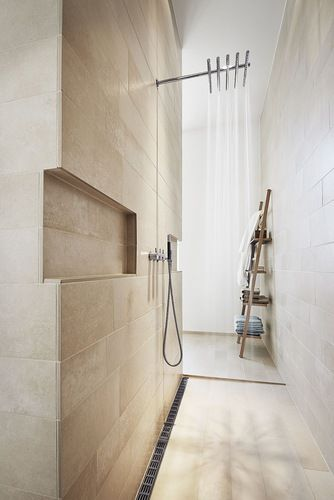 peaceful ideas waterfall showers. Bathroom in Copenhagen with Vola shower system and Unidrain drain  I like the subtle wartmh of natural stone Nordic purity simplicity peace www bobedre dk ba os n rdicos