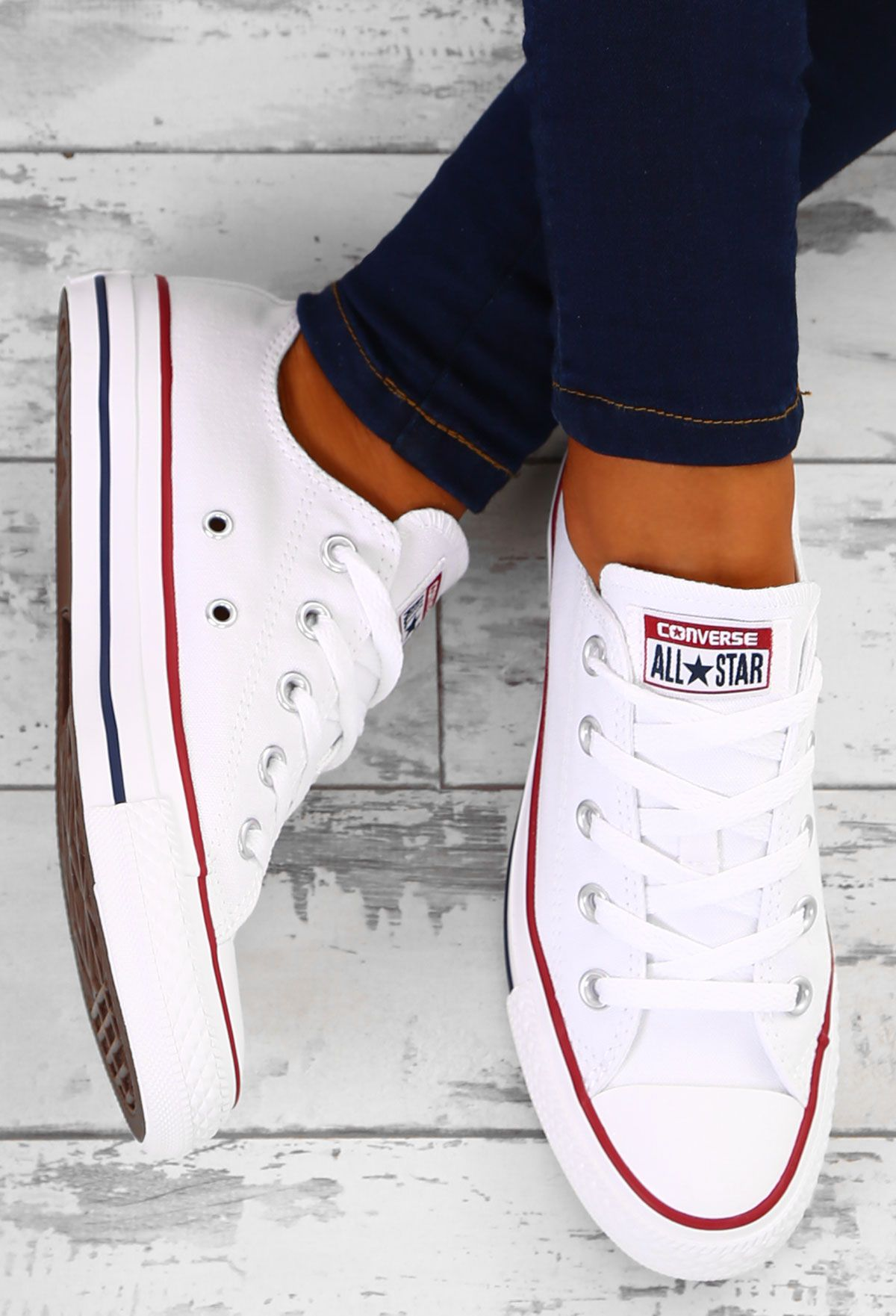 539b52ce23a1e8 Be a total Converse cutie in these classic white Converse trainers! These  Chuck Taylor Converse feature the classic navy and red stripe and will go  with ...
