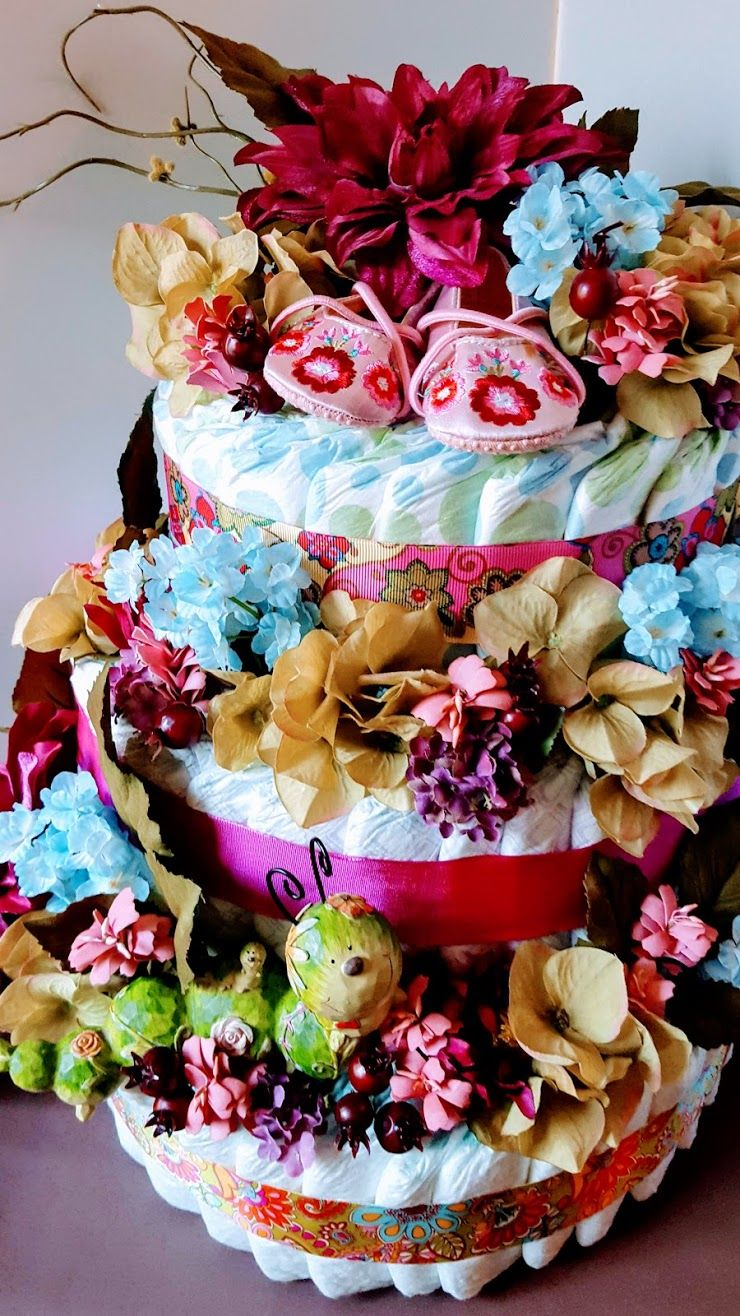 Flower Themed Diaper Cake with Baby Shoes Diaper cake